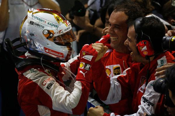 Marina Bay Circuit, Singapore. Sunday 20 September 2015. Sebastian Vettel, Ferrari, 1st Position, celebrates victory in Parc Ferme with his team. World Copyright: Alastair Staley/LAT Photographic ref: Digital Image _79P3843