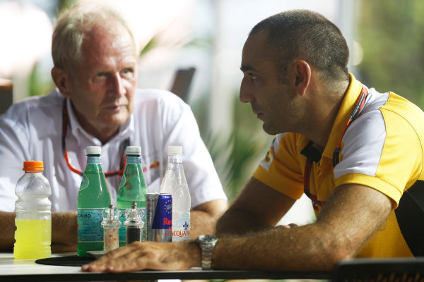 Marina Bay Circuit, Singapore. Saturday 19 September 2015. Helmut Markko, Consultant, Red Bull Racing, with Cyril Abiteboul, Head Engineer, Renault Sport F1. World Copyright: Alastair Staley/LAT Photographic ref: Digital Image _R6T6081