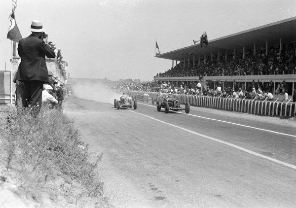 Achille Varzi, Alfa Romeo Tipo B, leads Philippe Étancelin, Maserati 8CM, at the start of the race.