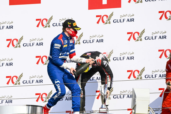 Race Winner Robert Shwartzman (RUS, PREMA RACING) and Louis Deletraz (CHE, CHAROUZ RACING SYSTEM) celebrate on the podium with the chamapgne