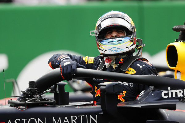 Daniel Ricciardo, Red Bull Racing RB14, celebrates as he climbs from his car after taking Pole Position.