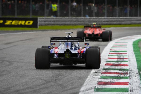 Charles Leclerc, Ferrari SF90, leads Daniil Kvyat, Toro Rosso STR14