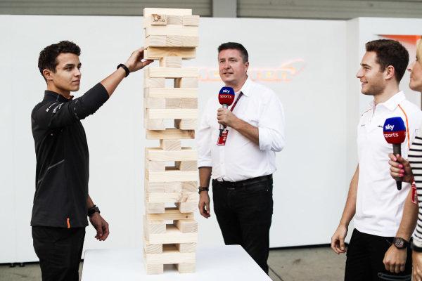 Lando Norris, McLaren, plays a game of giant Jenga with Stoffel Vandoorne, McLaren