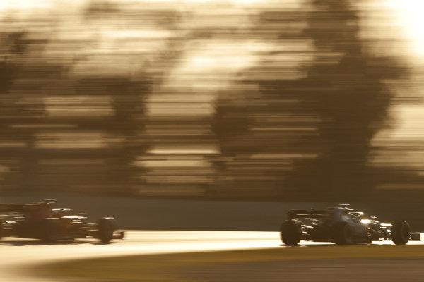 Lewis Hamilton, Mercedes-AMG F1 W10 EQ Power+ and Sebastian Vettel, Ferrari SF90