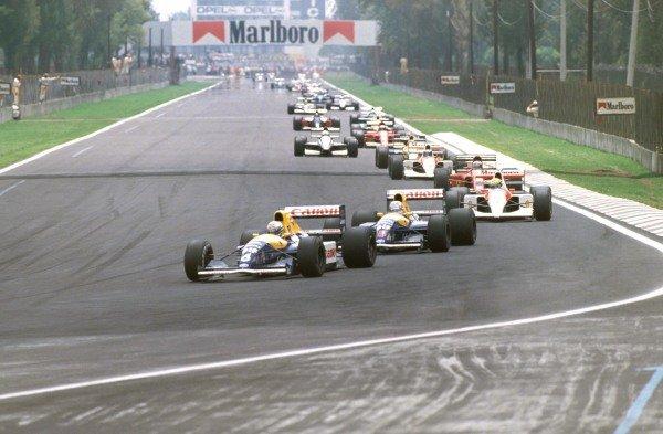 Riccardo Patrese, Williams FW14 Renault, leads Nigel Mansell, Williams FW14 Renault, and Ayrton Senna, McLaren MP4-6 Honda, at the start of the race.