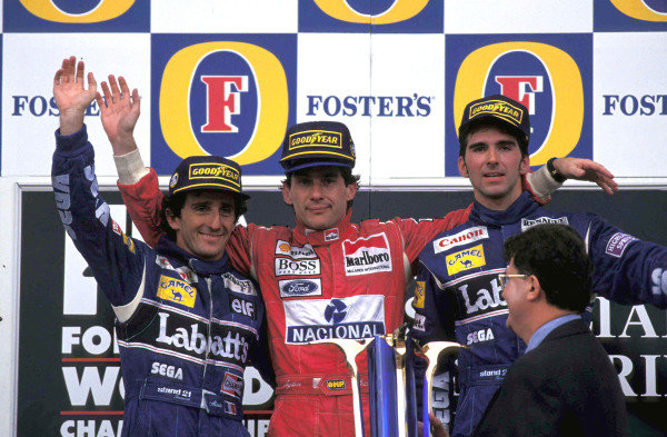 Alain Prost, 2nd position, Ayrton Senna, 1st position, and Damon Hill, 3rd position, on the podium.