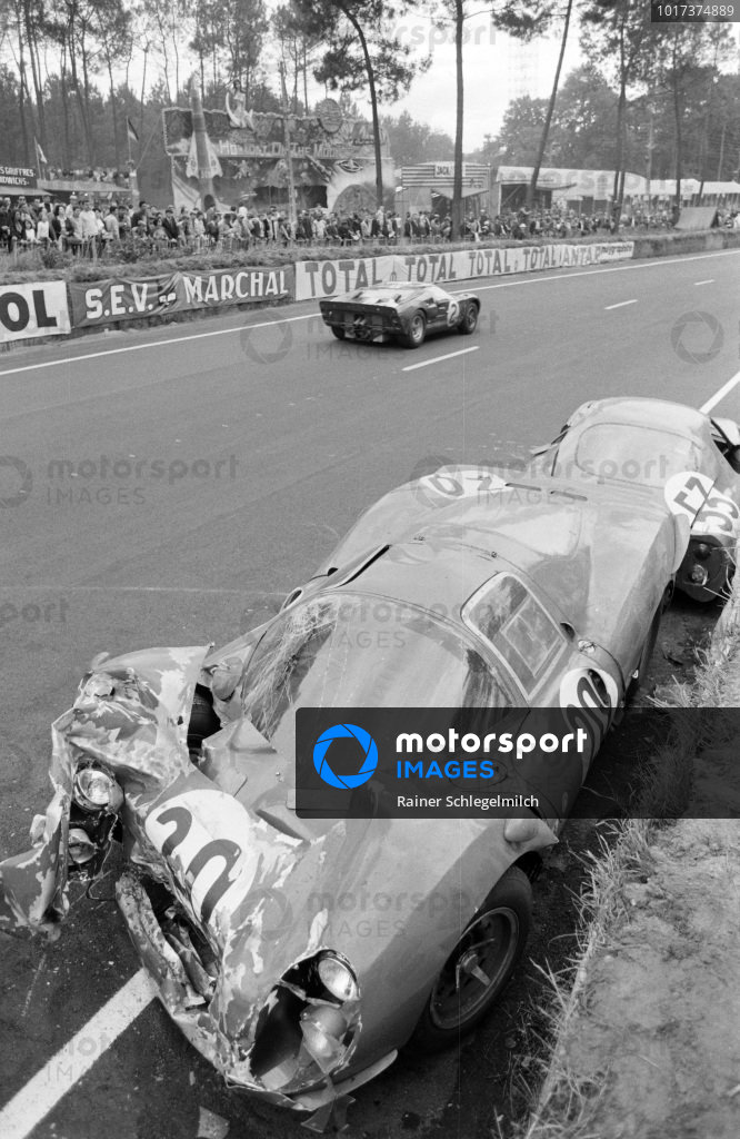 Bruce McLaren / Chris Amon, Shelby American Inc., Ford Mk II, passes the wreckage of Ludovico Scarfiotti / Mike Parkes' SpA Ferrari SEFAC, Ferrari 330 P3, and Georges Heligouin / Jean Rives' S.E.C. Automobiles C.D., C.D. SP66 - Peugeot 204.