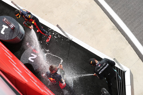Max Verstappen, Red Bull Racing, celebrates on the podium by spraying champagne alongside Lewis Hamilton, Mercedes-AMG Petronas F1