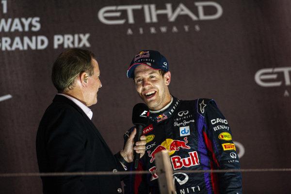 Sebastian Vettel, 1st position, is interviewed on the podium.