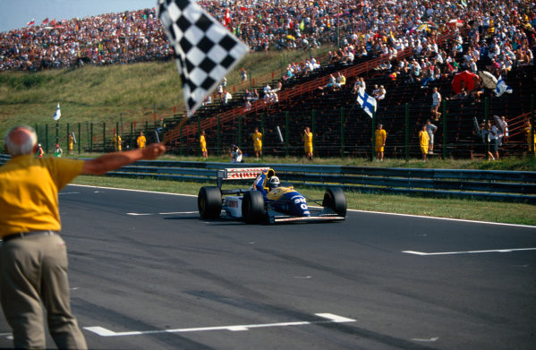 Hungaroring, Budapest, Hungary.13-15 August 1993.Damon Hill (Williams FW15C Renault) holds his fist aloft as he takes the chequered flag for his maiden Grand Prix win.Ref-93 HUN .World Copyright - LAT Photographic