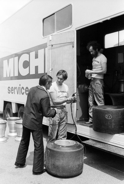 Pierre Dupasquier (FRA) Michelin, talks with Michelin engineers outside the Michelin Service truck in the paddock.Formula One Testing, Brands Hatch, England, c. June 1978.
