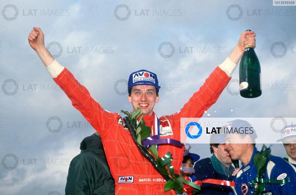 Marcel Albers (Ralt RT36-Mugen Honda), 1st position, celebrates with Class B winner, Paul Evans (Ralt RT35-Honda), and Gil de Ferran (Reynard 923-Mugen Honda), podium, portrait. World Copyright: LAT Photographic.Ref:  92BF301