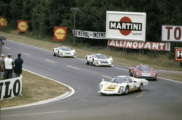 Le Mans, France. 18 - 19 June 1966.Udo Schutz/Piet de Klerk (#32 Porsche 906/6LH), 6th position, leads Mike Salmon/David Hobbs (#36 Ferrari Dino 206S), retired, Gunther Klass/Rolf Stommelen (#58 Porsche 906/6), 7th position and Peter Gregg/Sten Axelsson (#33 Porsche 906/6), retired, action. World Copyright: LAT PhotographicRef: 66LM03