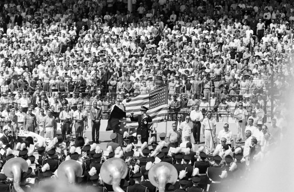 A band plays the national anthem before the race.