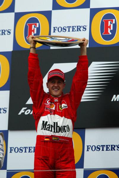 2002 Qantas Australian Grand Prix - Race.Albert Park, Melbourne, Australia. 3rd March 2002.Michael Schumacher (Ferrari) celebrates on the podium.World Copyright - LAT PhotographicRef: 12 5mb Digital Image Only