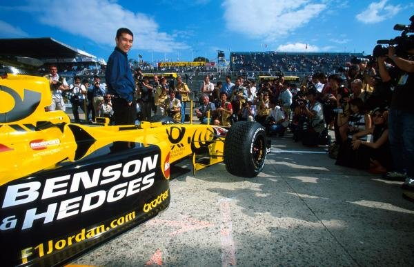 Takuma Sato (JPN) poses in front of the Jordan EJ11. He will drive for the team in 2002.
