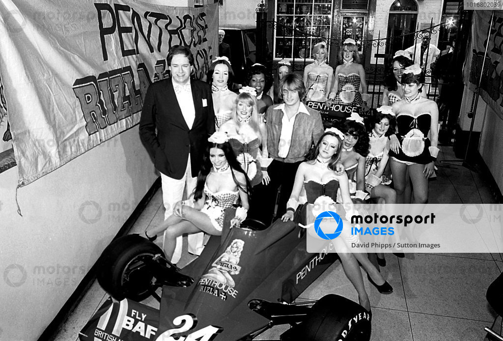 Lord Alexander Hesketh (GBR) (Left) Hesketh Team Owner, and 1977 driver Rupert Keegan (GBR), in car, with the Penthouse Pets at the branding launch of Penthouse Rizla Racing Hesketh 308E. Formula One World Championship, c. May 1977.