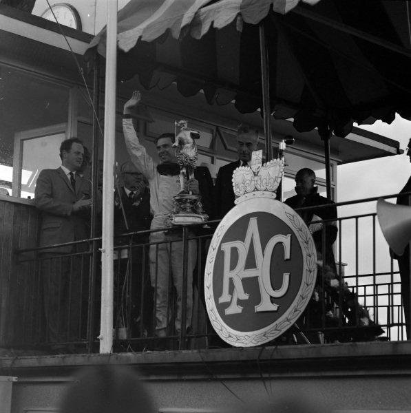 Jim Clark, 1st position, celebrates on the podium.