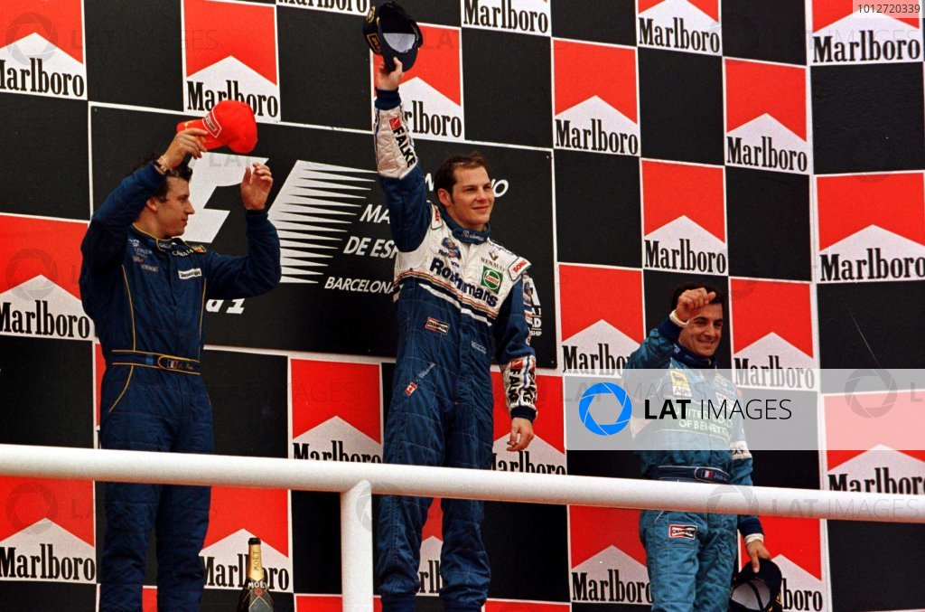 1997 Spanish Grand Prix.Catalunya, Barcelona, Spain.23-25 May 1997.Jacques Villeneuve (Williams Renault), Olivier Panis (Prost Mugen Honda), Jean Alesi (Benetton Renault) after finishing in 1st, 2nd and 3rd positions respectively.World Copyright - Leicester/LAT Photographic