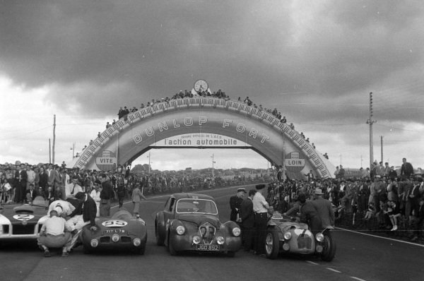 """The cars of Briggs Cunningham / Phil Walthers, B.S. Cunningham, Cadillac Spider """"Le Monstre"""", Auguste Lachaize / Albert Debille, Auguste Lachaize, Panhard Dyna X84 Sport, Nigel Mann / Mortimer Morris-Goodall, N.H. Mann, Healey Silverstone - Riley, and Pierre Meyrat / Guy Mairesse, Talbot Lago MD, after the race."""