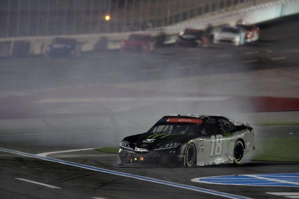 Riley Herbst, Joe Gibbs Racing Toyota Monster Energy spins, Copyright: Jared C. Tilton/Getty Images.