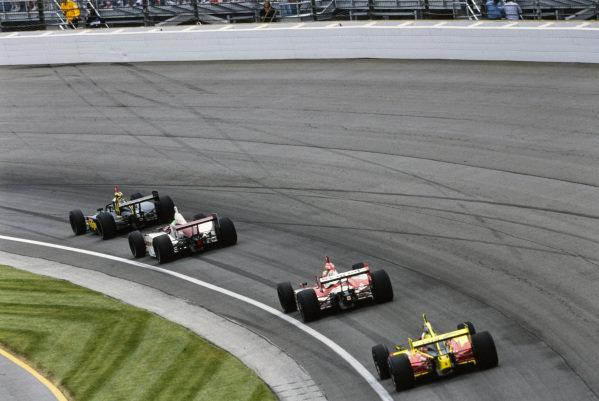 Scott Sharp, Kelley Racing, Dallara IR-03 Toyota, follows Dan Wheldon, Andretti Green Racing, Dallara IR-03 Honda, Toranosuke Takagi, Mo Nunn Racing, G-Force GF05 Toyota, and Robby McGehee, Panther Racing, Dallara IR-03 Chevrolet.
