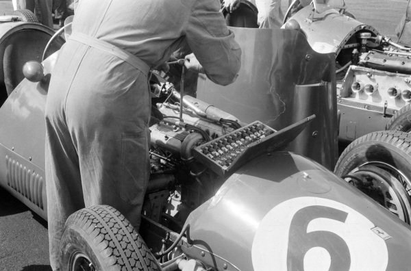 A mechanic working on the engine in Giuseppe Farina's Ferrari 500.