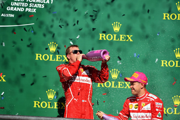 Kimi Raikkonen (FIN) Ferrari and Sebastian Vettel (GER) Ferrari celebrate on the podium with the chmpagne at Formula One World Championship, Rd17, United States Grand Prix, Race, Circuit of the Americas, Austin, Texas, USA, Sunday 22 October 2017.