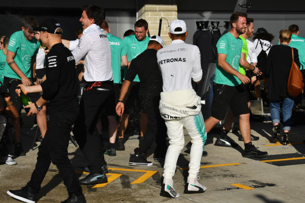 Lewis Hamilton (GBR) Mercedes AMG F1 celebrates with the champagne and the team at Formula One World Championship, Rd17, United States Grand Prix, Race, Circuit of the Americas, Austin, Texas, USA, Sunday 22 October 2017.