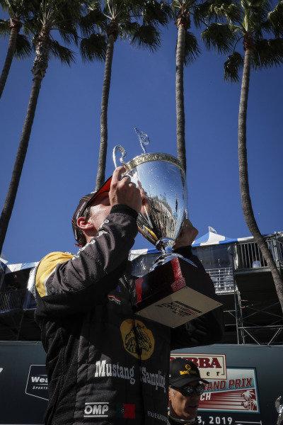 #5 Mustang Sampling Racing Cadillac DPi, DPi: Filipe Albuquerque kisses the trophy