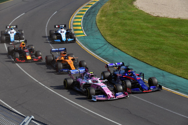 Daniil Kvyat, Toro Rosso STR14, leads Lance Stroll, Racing Point RP19, Carlos Sainz Jr., McLaren MCL34, Pierre Gasly, Red Bull Racing RB15, George Russell, Williams Racing FW42, and Robert Kubica, Williams FW42, at the start