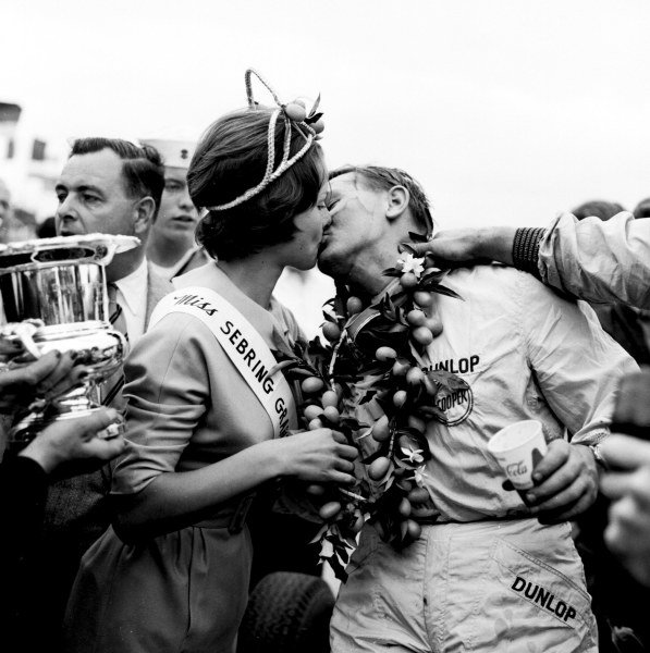 1959 United States Grand Prix.Sebring, Florida, USA.10-12 December 1959.Bruce McLaren (Cooper T45 Climax) 1st position. McLaren receives a kiss and the trophy after becoming the youngest ever Grand Prix winner.Ref-5506.World Copyright - LAT Photogarphic