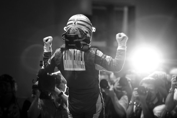 Race winner Fernando Alonso (ESP) Ferrari in parc ferme. Formula One World Championship, Rd 15, Singapore Grand Prix, Race, Marina Bay Street Circuit, Singapore, Sunday 26 September 2010.Note: This image has been digitally altered from the original, which is also available on the archive. (d10sin1827.jpg).