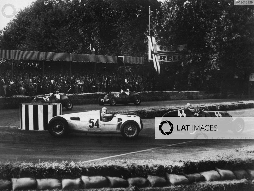 Sempione Park, Milan, Itlay. 28th June 1936.Tazio Nuvolari (Alfa-Romeo 12C-36), 1st position leads Achille Varzi (Auto Union C), 2nd position, Antonio Brivio (Alfa-Romeo 8C-35), 4th position and Giuseppe Farina (Alfa-Romeo 12C-36), 3rd position, action.World Copyright: LAT Photographic.Ref: B/W Print.