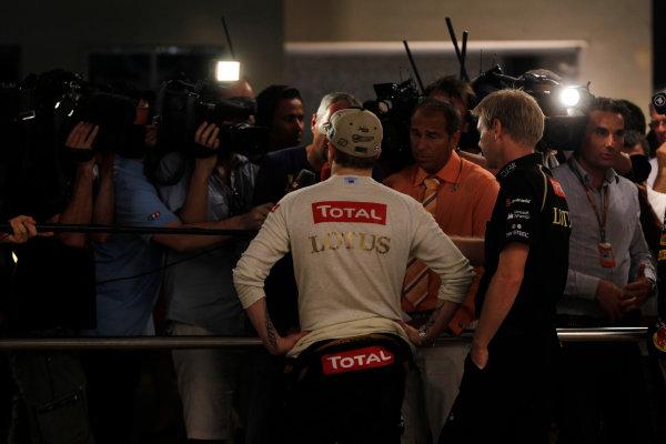 Yas Marina Circuit, Abu Dhabi, United Arab Emirates Sunday 4th November 2012. Kimi Raikkonen, Lotus GP, talks to the media after victory. World Copyright: Andrew Ferraro/  ref: Digital Image _Q0C2782