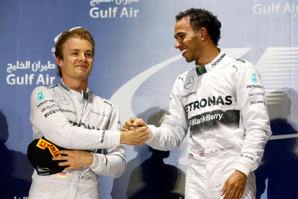 Bahrain International Circuit, Sakhir, Bahrain. Sunday 06 April 2014. Nico Rosberg, Mercedes AMG and Lewis Hamilton, Mercedes W05 celebrate on the podium. World Copyright: Alastair Staley/LAT Photographic. ref: Digital Image _R6T4480.JPG