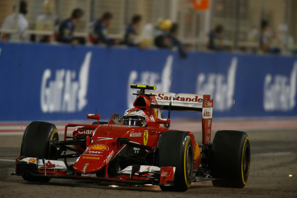 Bahrain International Circuit, Sakhir, Bahrain. Sunday 19 April 2015. Kimi Raikkonen, Ferrari SF-15T, 2nd Position, celebrates after crossing the line. World Copyright: Glenn Dunbar/LAT Photographic. ref: Digital Image _89P1111