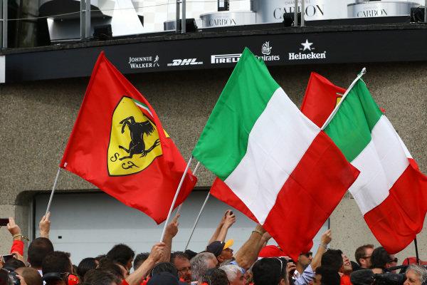 Ferrari and Itallian podium flags .