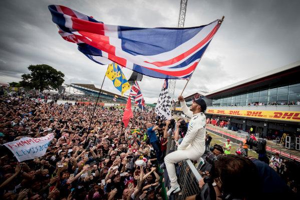 Silverstone, Northamptonshire, UK.  Sunday 16 July 2017. Lewis Hamilton, Mercedes AMG, 1st Position, celebrates victory with the British fans. World Copyright: Dunbar/LAT Images  ref: Digital Image _X4I8578