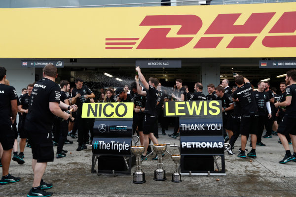 Suzuka Circuit, Japan. Sunday 9 October 2016. The Mercedes AMG team celebrate securing their 3rd consecutive constructors title. World Copyright: Dunbar/LAT Photographic ref: Digital Image _X4I8690