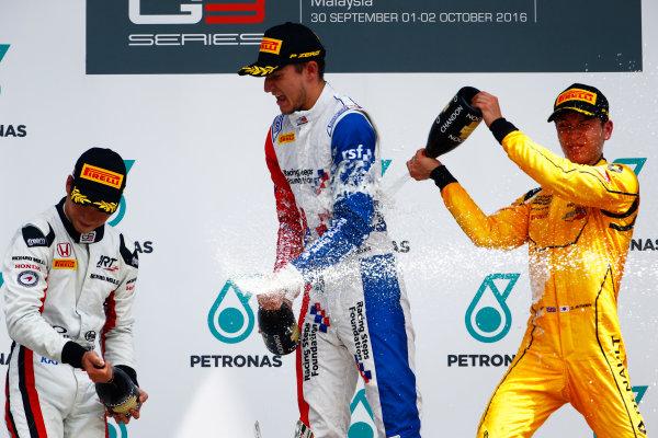 Jake Dennis (GBR, Arden International) Nirei Fukuzumi (JPN, ART Grand Prix) and Jack Aitken (GBR, Arden International)  2016 GP3 Series Round 8 Sepang International Circuit, Sepang, Malaysia. Sunday 2 October 2016  Photo: Zak Mauger/GP3 Series Media Service ref: Digital Image _X0W9296