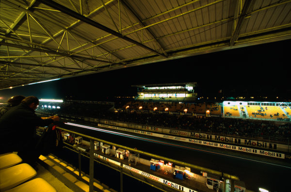 Le Mans, France. 12th - 13th June 1999. At night in the main Grandstand, atmosphere. World Copyright: LAT Photographic. Ref: 99LM14.