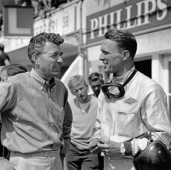 Le Mans, France. 20th - 21st June 1964. Dan Gurney (AC Cobra Daytona), 4th position, chats with team boss Carroll Shelby, portrait.  World Copyright: LAT Photographic. Ref:  19837A.