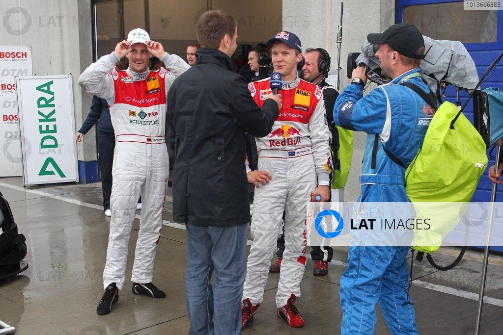 Winner's interview for Mattias Ekstrom (SWE), Audi Sport Team Abt Sportsline, Red Bull Audi A4 DTM (2009) with a happy Martin Tomczyk (GER), Audi Sport Team Phoenix, Schaeffler Audi A4 DTM (2008) (2nd).DTM, Rd8, Oschersleben, Germany, 16-18 September 2011 Ref: Digital Image dne1118se542