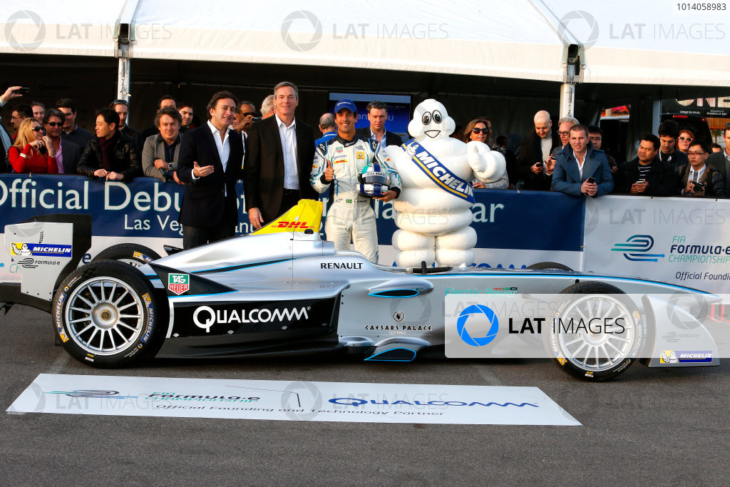5-6 January, 2014, Las Vegas, Nevada USA Alejandro Agag, CEO Formula E Holdings, Dr. Paul E. Jacobs, Chairman and CEO of Qualcomm Incorporated, former F1 driver Lucas di Grassi, and Bibendum (the Michelin Man) pose with the new Spark-Renault SRT_01E Formula E car. ©2014, Lesley Ann Miller LAT Photo USA