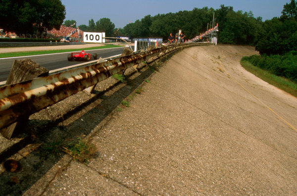 Monza, Italy.5-7 September 1997.The first Banked Corner of the old Monza circuit which still remains, with Michael Schumacher passing by towards the Rettifilo.Ref-97 ITA 05.World Copyright - LAT Photographic