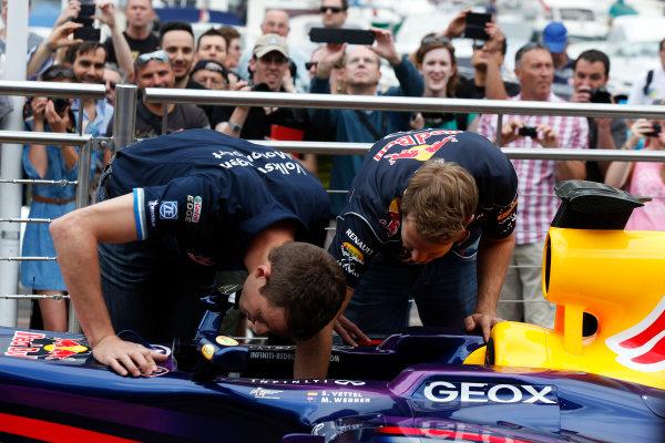 Monte Carlo, Monaco 22nd May 2013 Sebastian Vettel, Red Bull Racing meets Sebastian Ogier and shows him his car World Copyright: Charles Coates/LAT Photographic ref: Digital Image _N7T0483