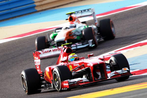 Bahrain International Circuit, Sakhir, Bahrain Sunday 21st April 2013 Felipe Massa, Ferrari F138, leads Adrian Sutil, Force India VJM06 Mercedes.  World Copyright: Andy Hone/LAT Photographic ref: Digital Image HONY1632
