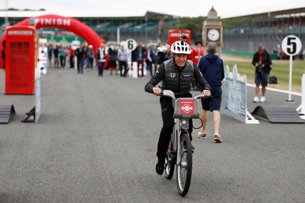Silverstone, Northamptonshire, UK.  Thursday 13 July 2017. Stoffel Vandoorne, McLaren, takes part in a bicycle-related event. World Copyright: Glenn Dunbar/LAT Images  ref: Digital Image _31I2299