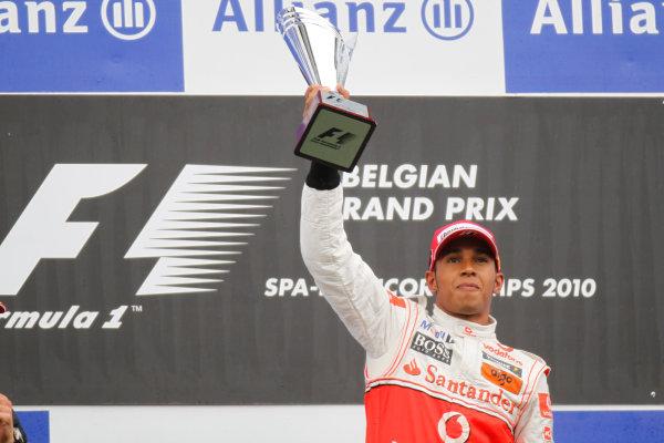 Spa-Francorchamps, Spa, Belgium 29th August 2010 Lewis Hamilton, McLaren MP4-25 Mercedes, 1st position, lifts his trophy on the podium. Portrait. Podium.  World Copyright: Charles Coates/LAT Photographic ref: Digital Image _G7C0657